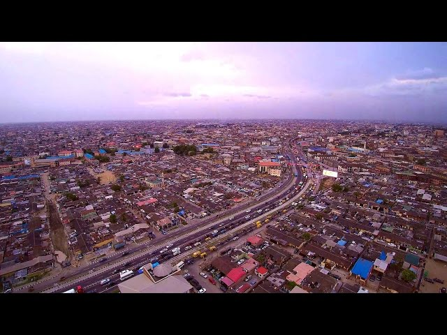 Drone Watching Rush Hour Traffic on Western Avenue in Surulere Lagos at Sunset