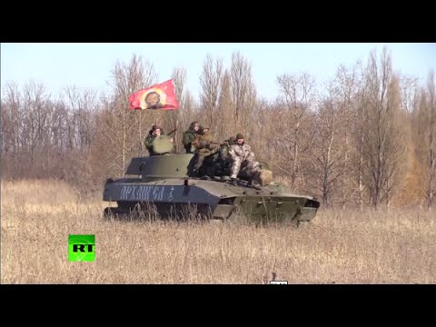 RAW: E. Ukraine rebels withdraw heavy weaponry after ceasefire