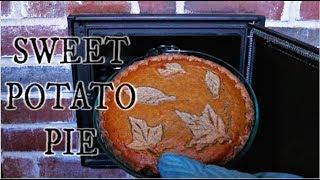 Cooking sweet potato pie in a masonry heater