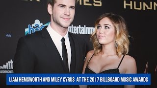 """Liam hemsworth joins miley cyrus backstage after her """"malibu"""" performance at the 2017 bma"""