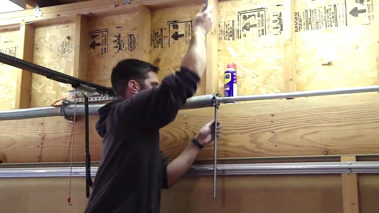 How To Tighten The Garage Door Spring Youtube