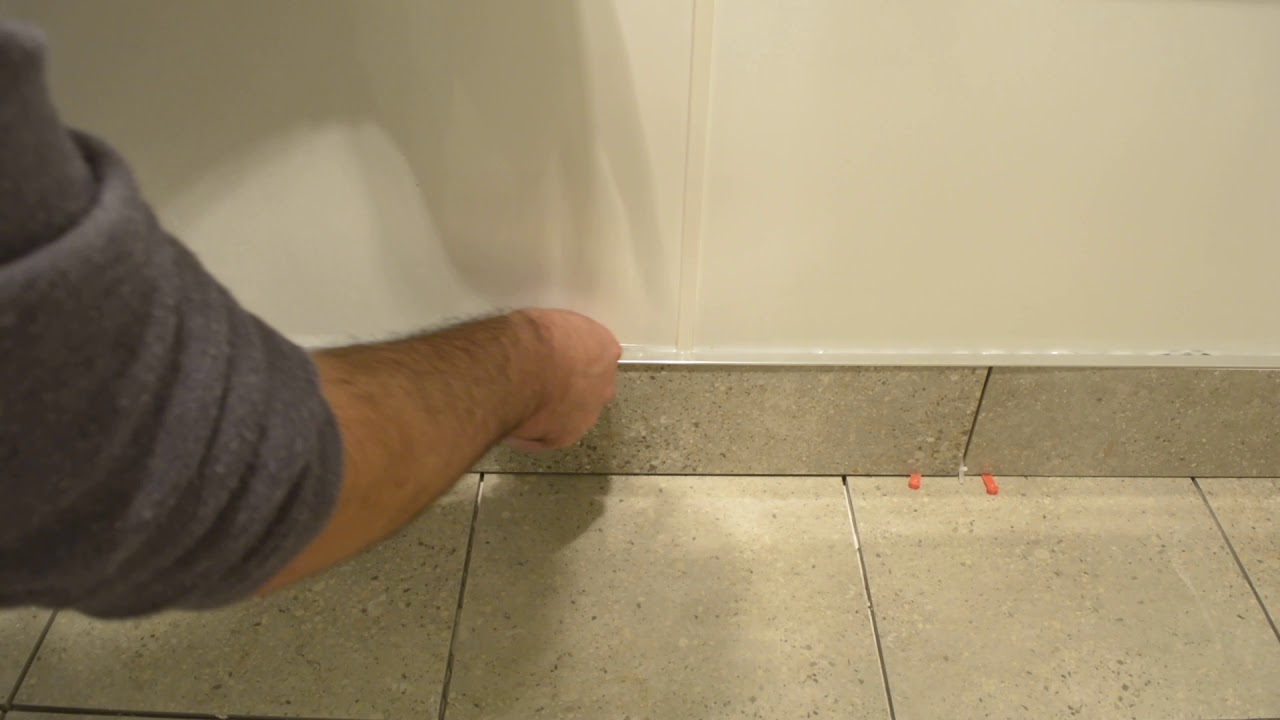 inserting capping trim into skirting tiles