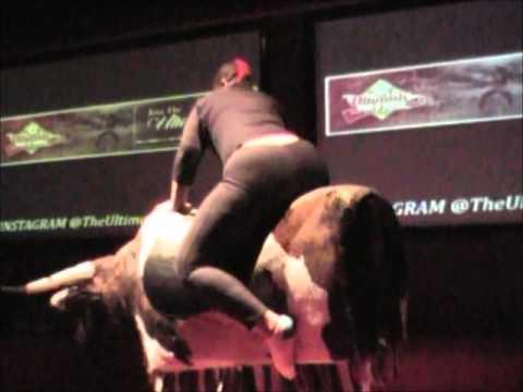 Sexy girl riding bull
