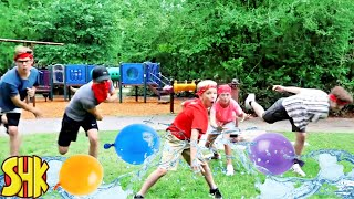 Sneaky Summer Camp Water Balloon Battle! with SuperHeroKids Summer Funny Family Videos Compilation