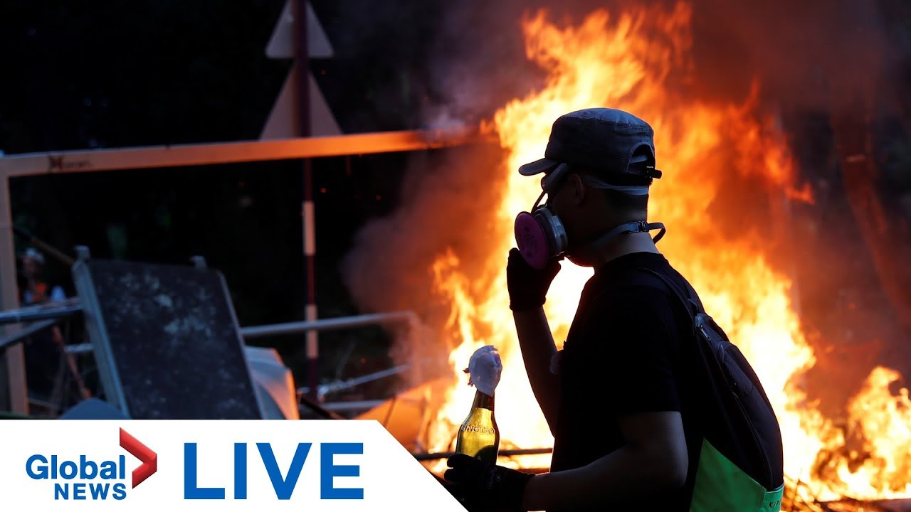 Hong Kong protesters light fires in police standoff outside Chinese University | LIVE