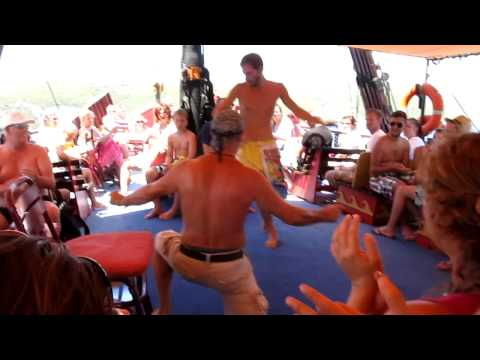Greek sailors and tourists dancing - Odyssey Cruise Boat