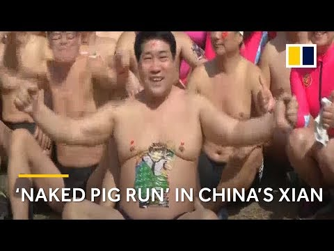 Winter swimmers strip to their underwear for China's 'naked pig run'