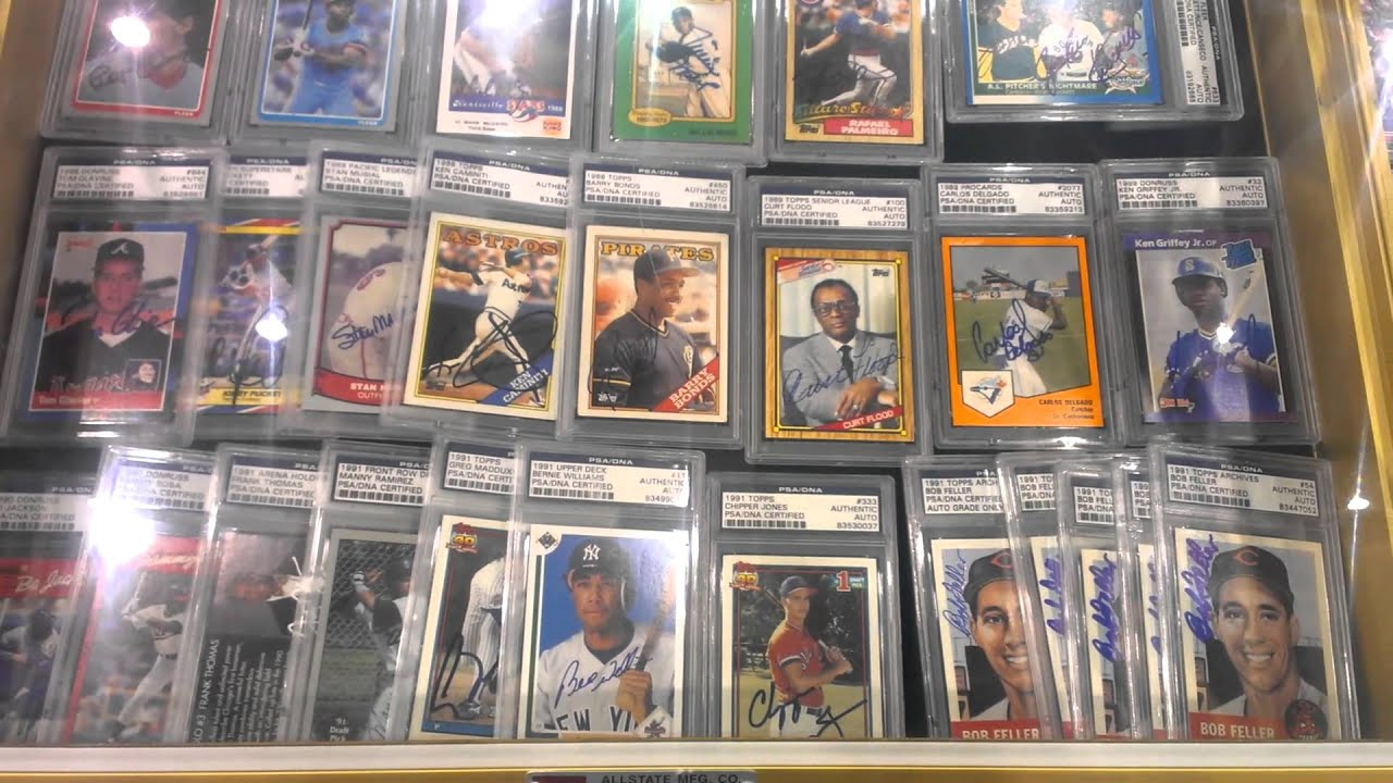 Baseball Card Exchange At 2014 National Sports Collectors Convention