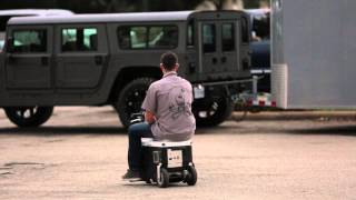 Funny Guy On Motorized Cooler At Tx2k14 Hd