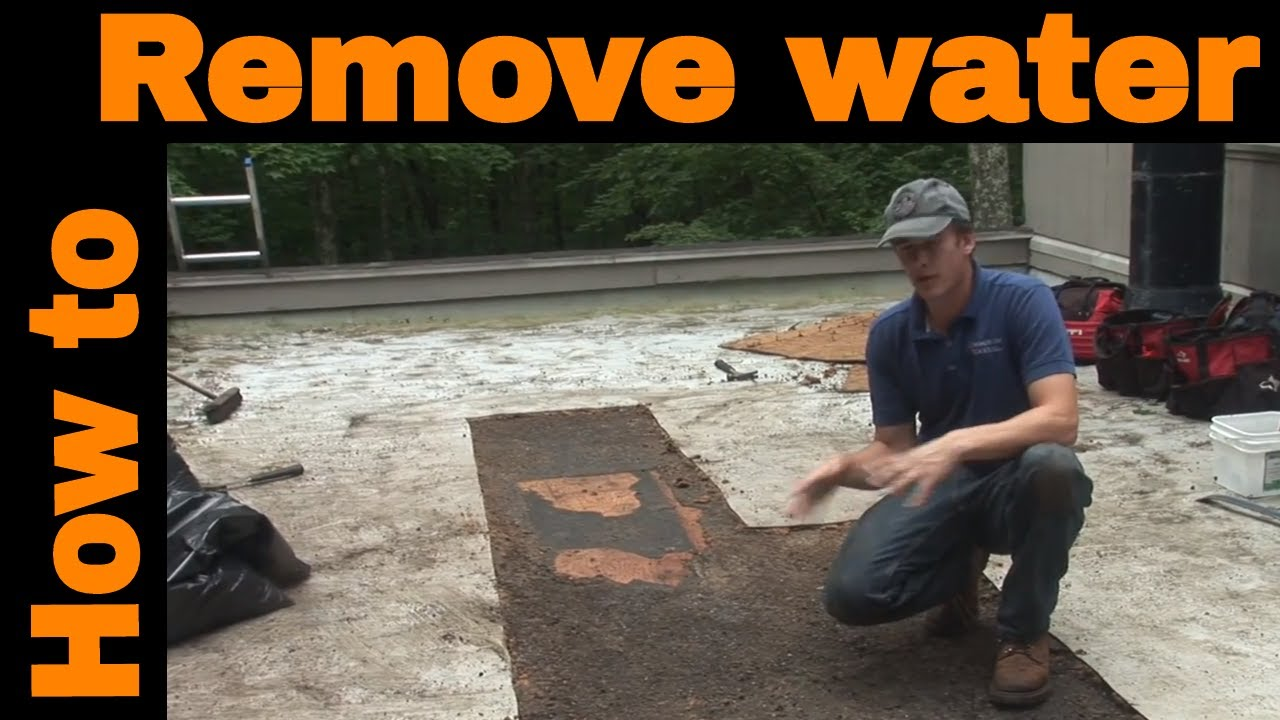 How To Remove Water From A Flat Roof Youtube