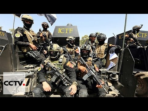 Iraqi military retakes key oil town from IS