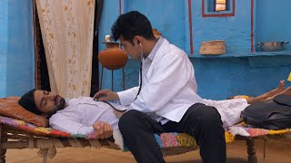 Young well-dressed doctor observing his unconscious patient at the village home