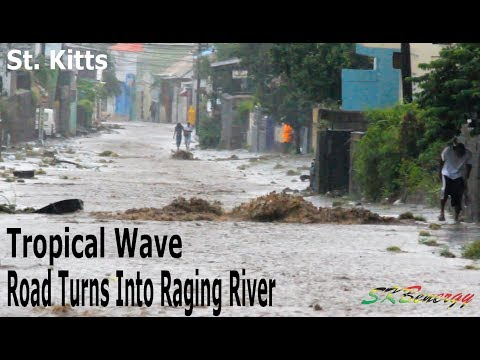 Tropical Wave over St. Kitts tuning this road into a raging river !!!