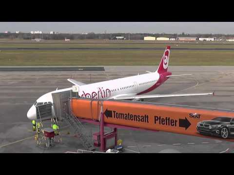 Air Berlin Airbus A321 docking the gangway at Berlin Tegel airport