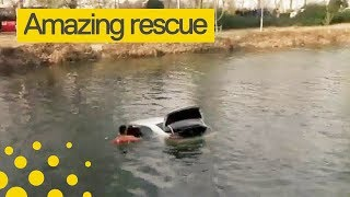 Firefighters Save Woman Trapped in Flooded Car