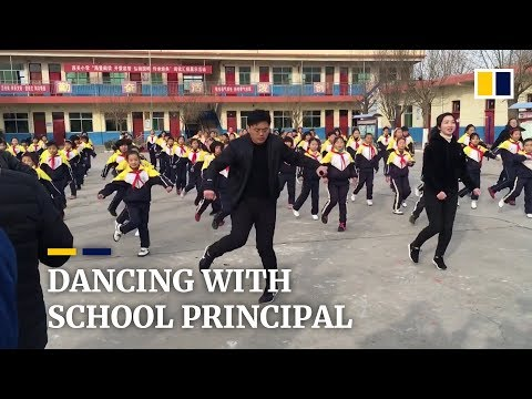 chinese-school-principal-teaches-students-shuffle-dance-during-break