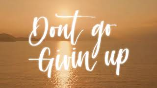 Agatino Romero - Don't Go Givin Up (ft. JRand) Lyric Video