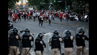 Clashes between River Plate fans an riot police