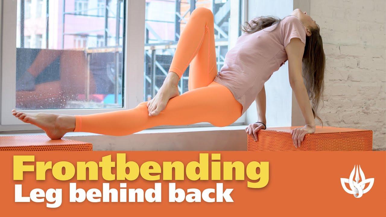 Flexible. Frontbending Contortion. Leg behind back.
