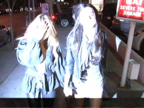 Tila Tequila and Courtney Semel are all over each other at Viper Room.