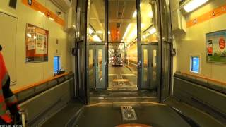 Driving on and off a Eurotunnel train in a coach.