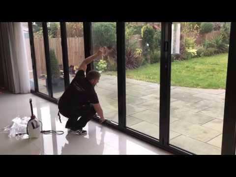 PR Solar Window Film Ltd applying one-way privacy window film to bi-folding doors