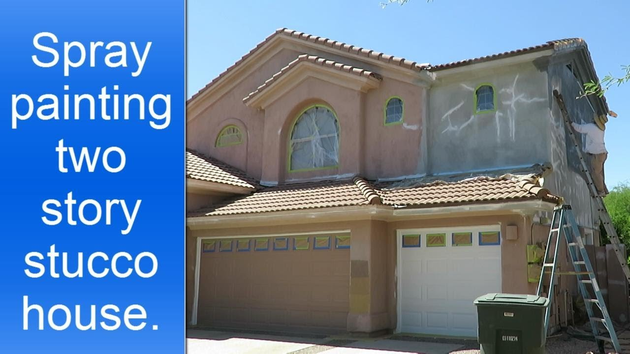 Spray painting exterior two story stucco house. - YouTube