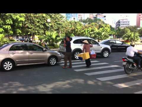 Mediawok cameraman crossing street in Ho Chi Minh City