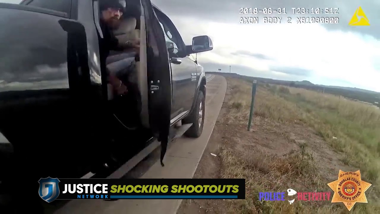 Download Man jumps out of truck pointing gun at deputies, prompting police shootout