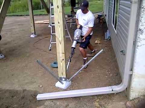 Diamond pier footing install youtube for How to build a post and pier foundation