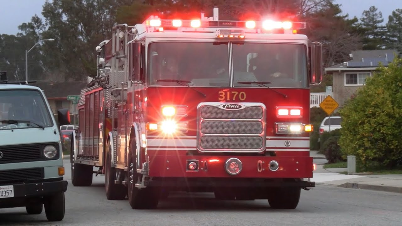 Fire Trucks Responding to and On-Scene at a Structure Fire