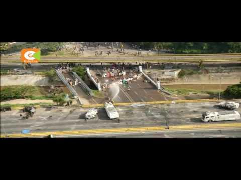 Tear gas flies as clashes erupt Venezuela