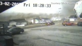 Tornado's destruction caught on security cam