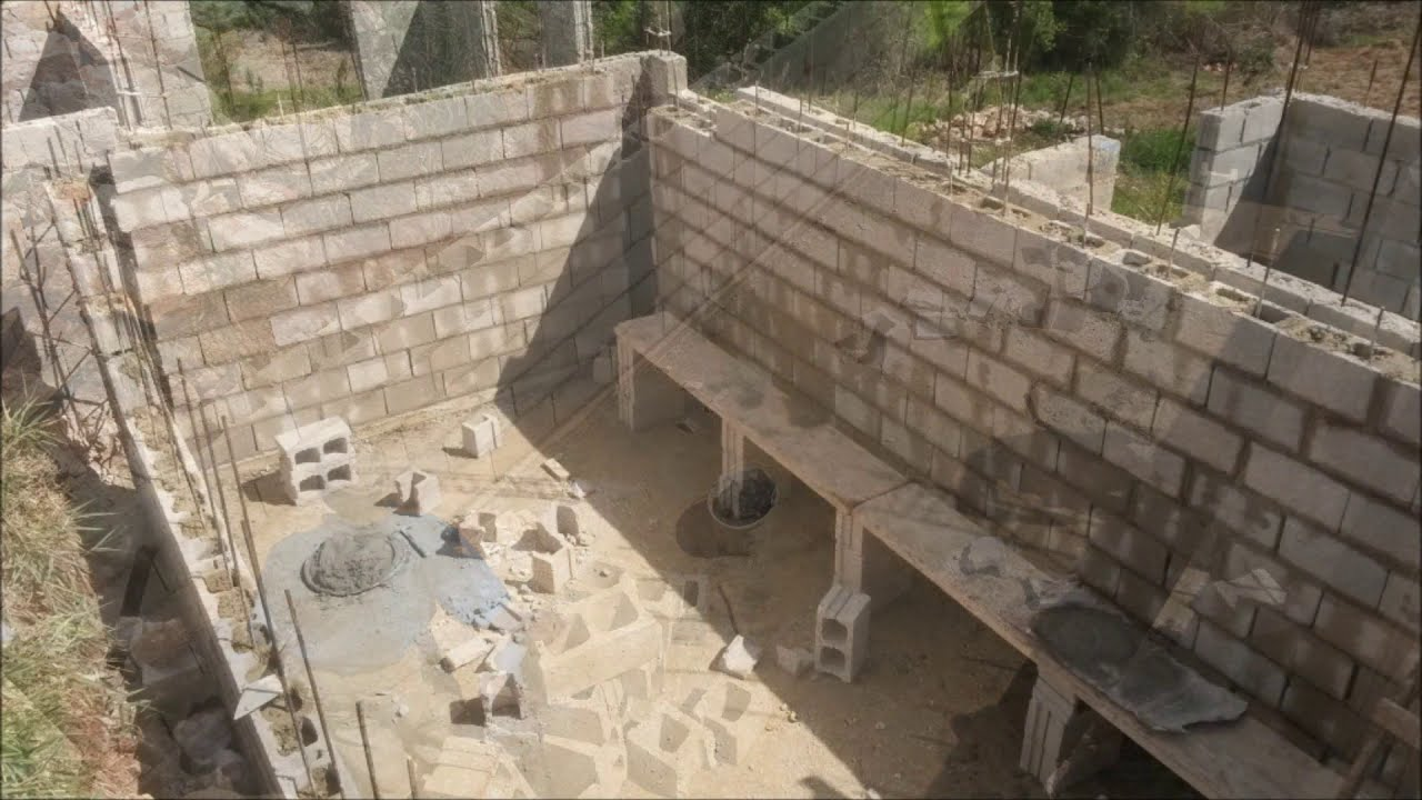 My jamaican dream house part 2 water tank building a for Building a house in jamaica