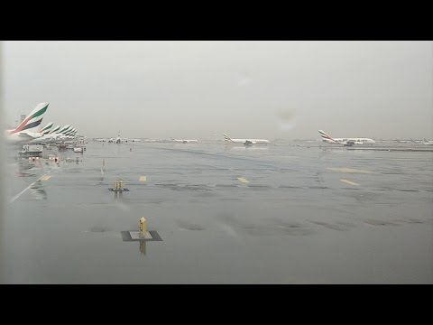 Rain in Dubai Emirates Airline Terminal 3 Plane Display