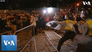 Riot Police Clash With Protesters in Hong Kong