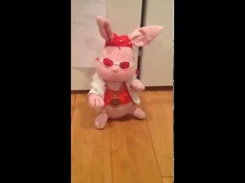 Fluffy B animated singing bunny (with Teen Titan Figurines)