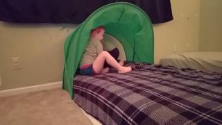 Felix and Emerson play with new bed tent