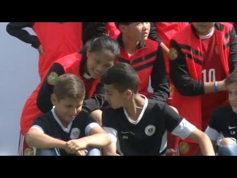 Xi and Merkel attend football match between German, Chinese youngsters