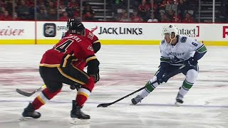 Boeser weaves through Flames beats Gillies with wrist shot