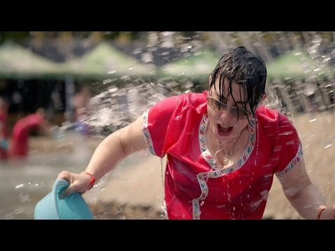 Sue takes part in the Dai water splashing - The Mekong River with Sue Perkins: Episode 4 - BBC Two