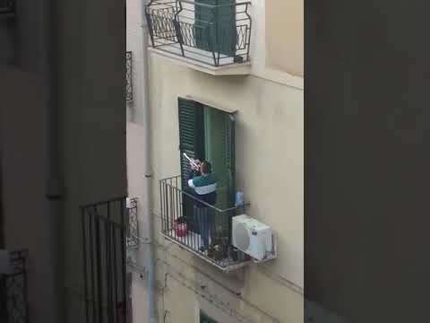 Trumpeter Performs 'Imagine' on Italian Balcony During Coronavirus Lockdown