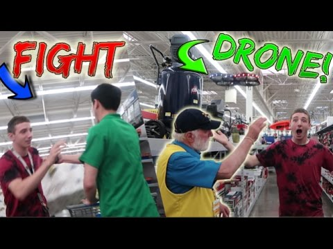 GUY TRIES TO FIGHT ME AT WALMART! (FLYING DRONES IN STORE)
