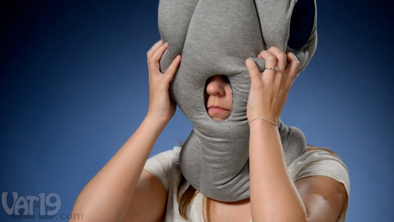 Nap anywhere with the Ostrich Pillow  YouTube