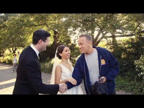 Watch This Couple's Shocked Reaction When Tom Hanks Crashes Their Wedding Photos