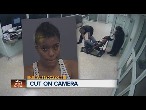 Warren police officer cuts off Detroit mother's sewn-on hair weave