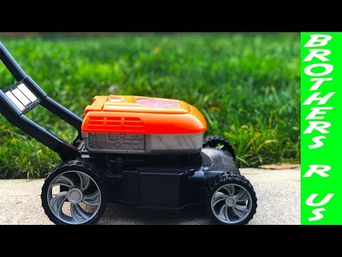 boy-and-toy-lawn-mower-in-the-fall-time