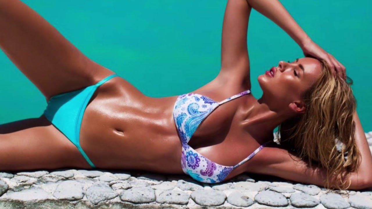 Gigi Hadid's Best Beach Moments With Swimsuit Illustrated