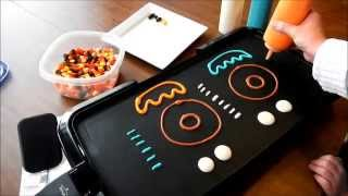 Repeat youtube video Pancake Art Tutorial: Donut by Jenni Price
