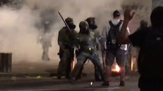 US riot police use tear gas and hit Portland protester with batons